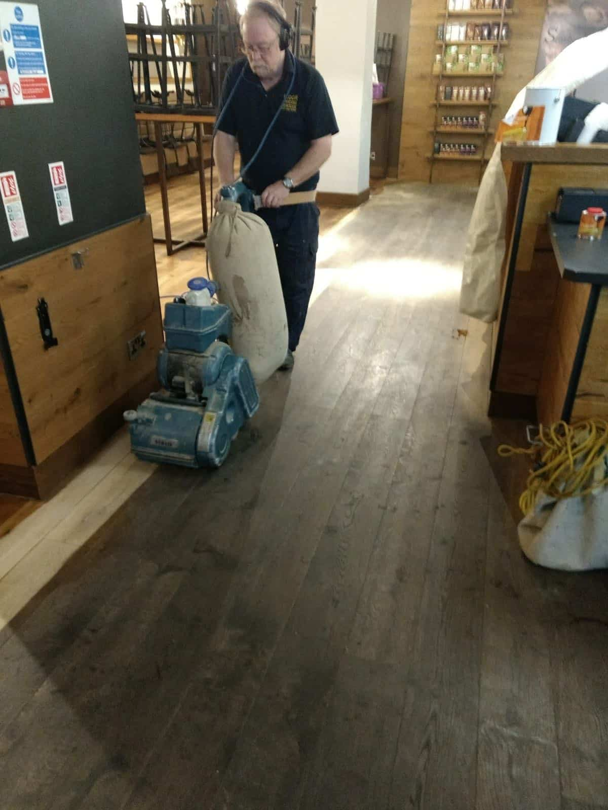 Sanding the floor at Starbucks Manchester